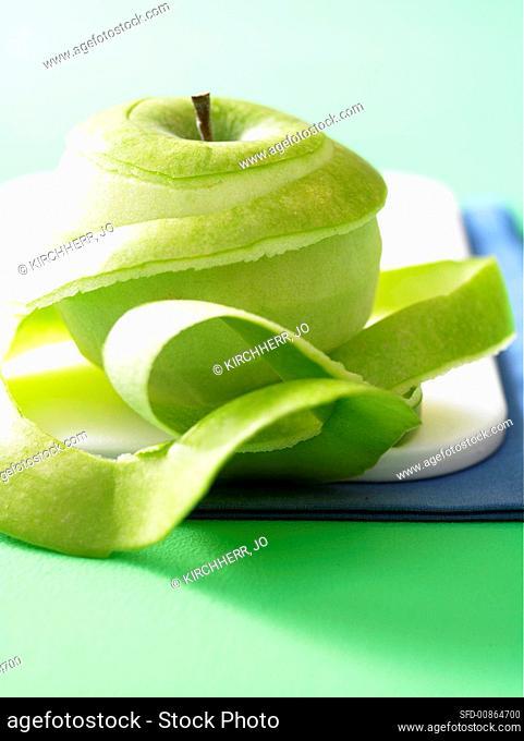 A peeled apple and peel