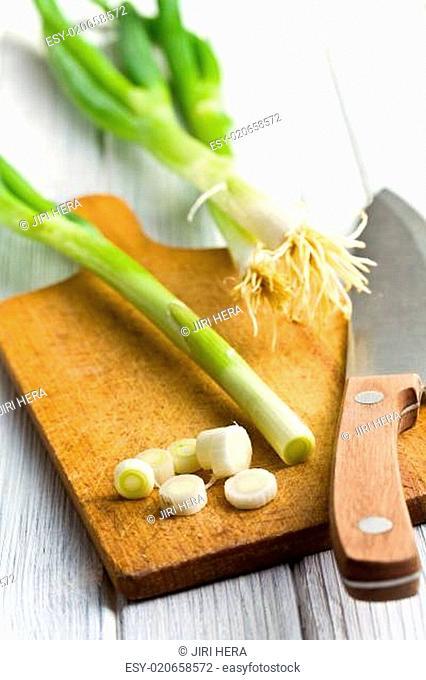 cutting spring onions