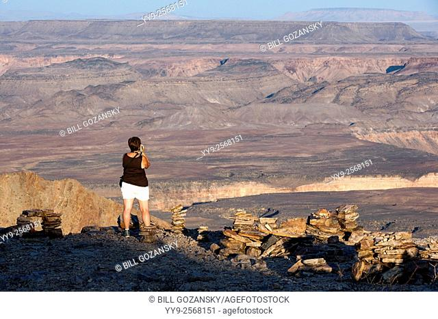 Tourist at Upper Fish River Canyon - near Fish River Lodge - Karas Region, Namibia, Africa