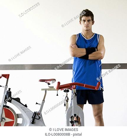 A young man standing in a gym