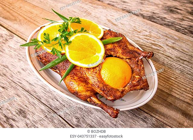 Roast duck with oranges and vegetables, close up