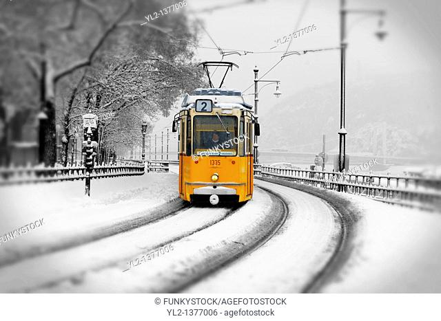 Traditional Yellow Budapest tram in the snow
