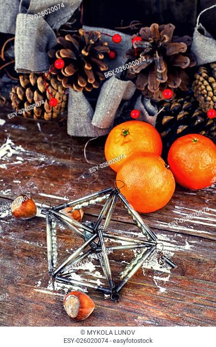 Winter composition with tangerines,pine cones and gifts