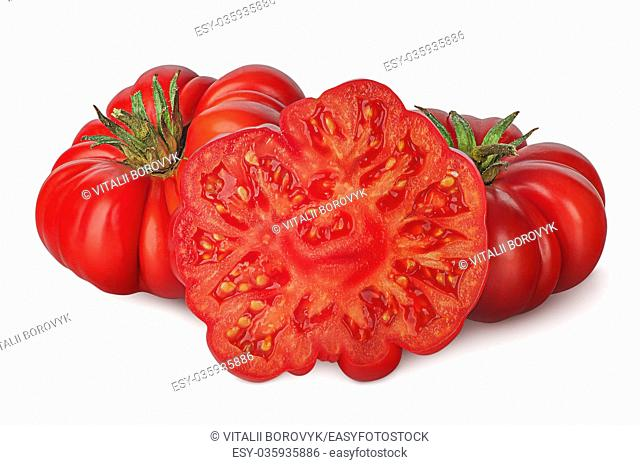 Whole and part of heirloom tomatoes isolated on white background