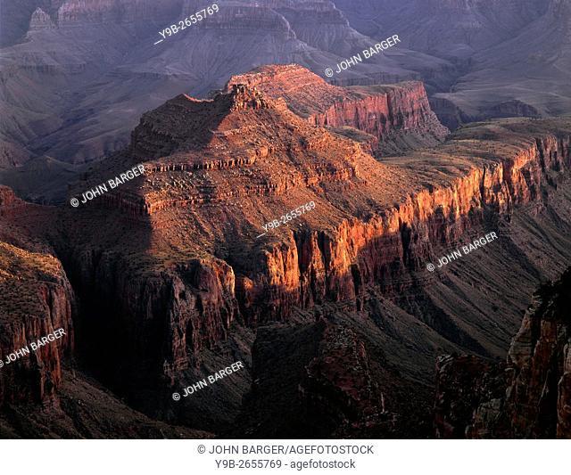 USA, Arizona, Grand Canyon National Park, North Rim, Setting sun warms Krishna Shrine, view south from Cape Royal