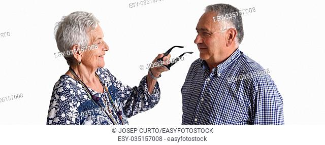 An older man putting on glasses to an older Woman