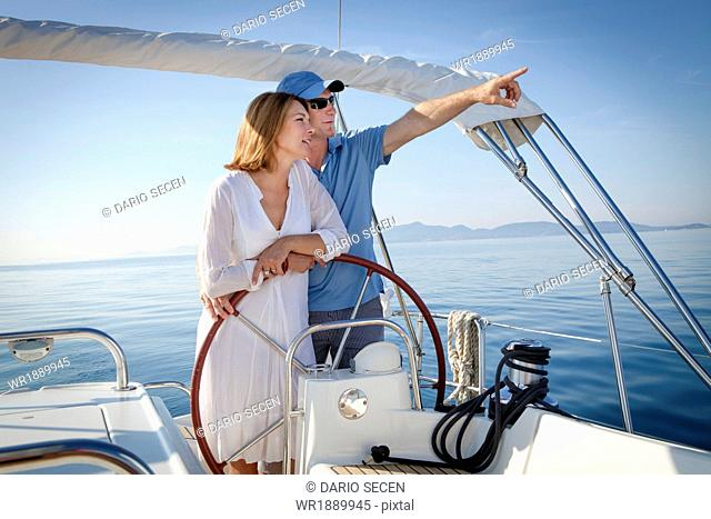 Mature couple sailing together, Adriatic Sea, Croatia