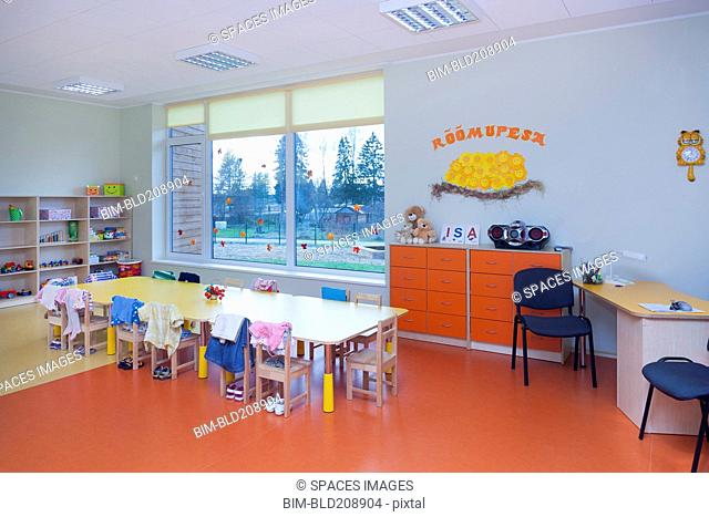 Classroom, activity room with furniture, tables and chairs