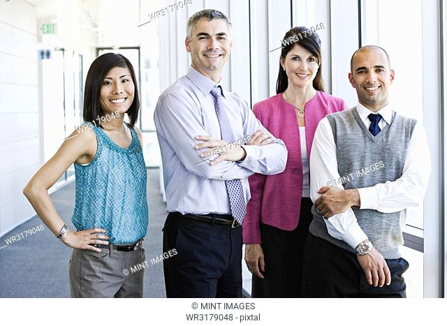 Mixed race team of business people in the lobby of a large office building