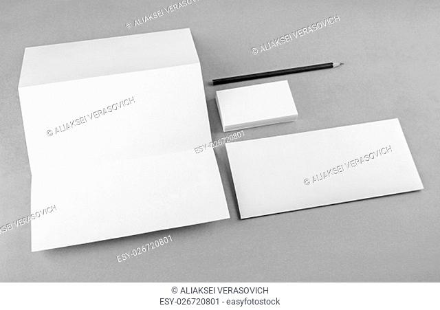 Photo of blank stationery set on gray background. Mock-up for branding identity. For design presentations and portfolios. Grayscale image