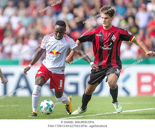 Dorfmerkingen's Niklas Weissenberger (R) and Leipzig's Naby Deco Keita vie for the ball during the German Football Association (DFB) Cup first-round match...