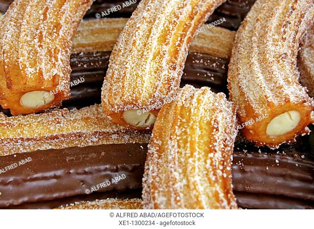 Chocolate and cream 'churros' (typical pastries), Spain