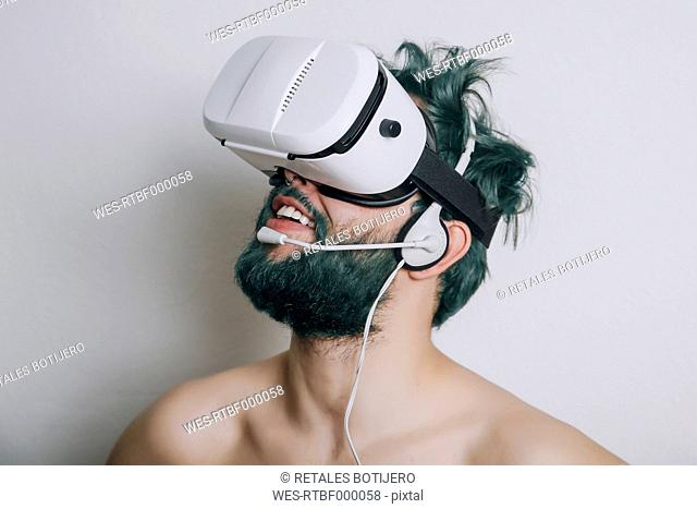 Shirtless man wearing Virtual Reality Glasses and headset