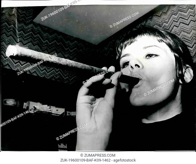 1964 - A Long Smoke: Sue Fleming, of Sydney, New South Wales, Australia, a cigar smoker, wants to cut down to one per day