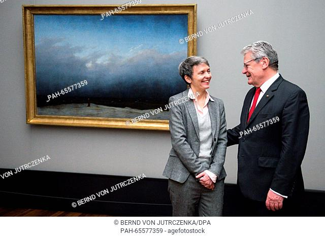 "German President Joachim Gauck is guided by restorer Kristina Moesl (l) through the special exhibition """"Der Moench ist zurueck"""" (lit"