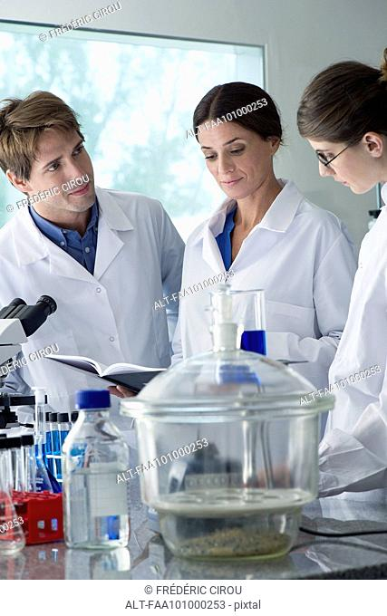 Scientists conducting experiment in laboratory