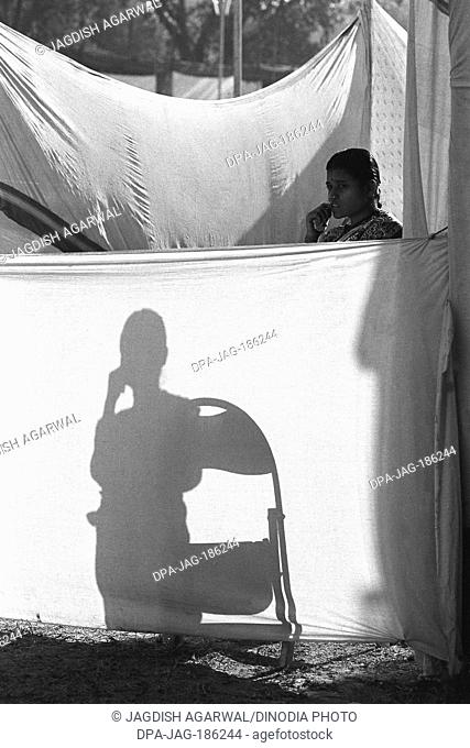Woman and shadow Vautha fair Gujarat India Asia 1983