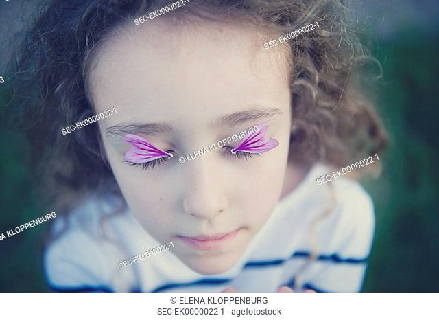 Italy, Girl (10-12) with flower petals on her eyes