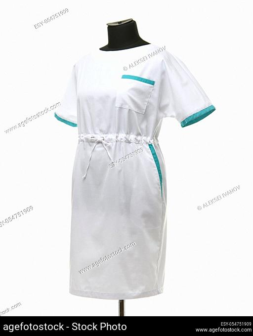 Female medical gown on a mannequin for clothes on a white background