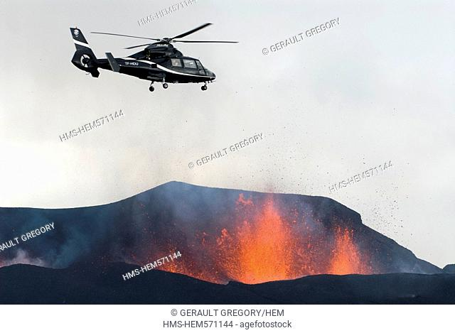 Iceland, Sudurland Region, helicopter flying over the Fimmvorduhals Volcano, volcanic eruption between the Glacier Eyjafjallajokull and the Glacier...