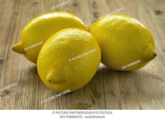 Three whole fresh yellow lemons