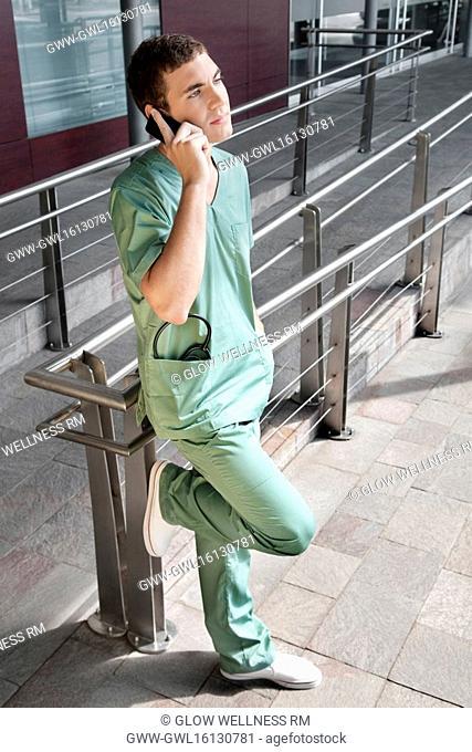 Male nurse talking on a mobile phone