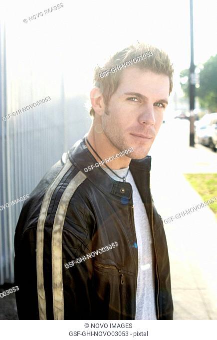 Man Wearing Striped Leather Jacket