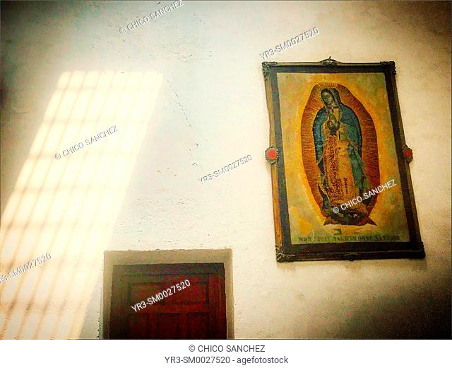 Lights enters a chapel decorated with the image of Our Lady of Guadalupe in San Juan Bautista church in Coyoacan, Mexico City, Mexico