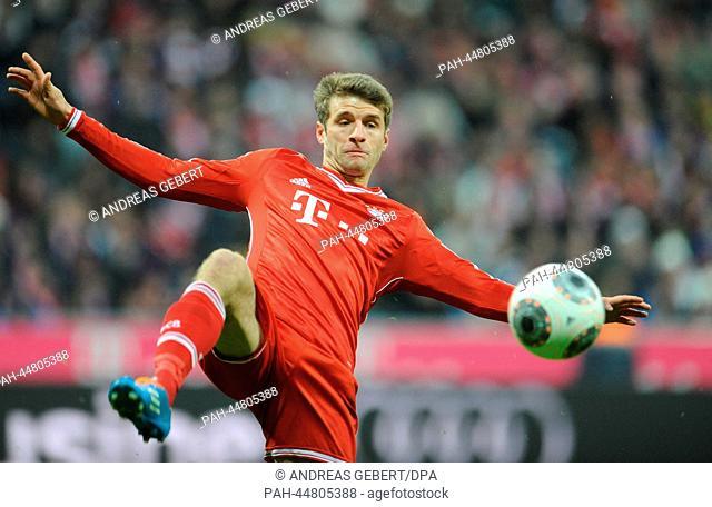 Munich's Thomas Mueller during the Bundesliga soccer match between Bayern Munich and Hamburger SV at Allianz Arena in Munich, Germany, 14.12.2013