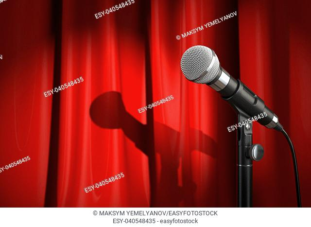 Microphone on stage with red curtain. Music or performance concept. . 3d illustration
