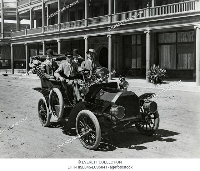 Four men in a Government automobile in front of the Adams Hotel, Phoenix, Arizona. March 23, 1907. They are employees of the Bureau of Reclamation