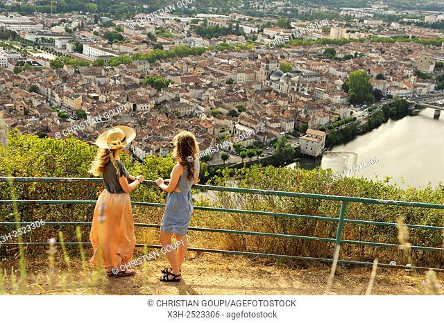 two young women admiring the city of Cahors from the viewpoint at Mont Saint Cyr, Lot department, region of Midi-Pyrenees, southwest of France, Europe