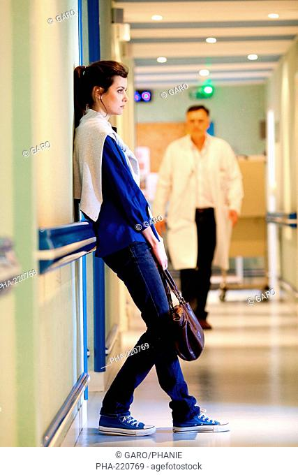Woman in hospital corridors