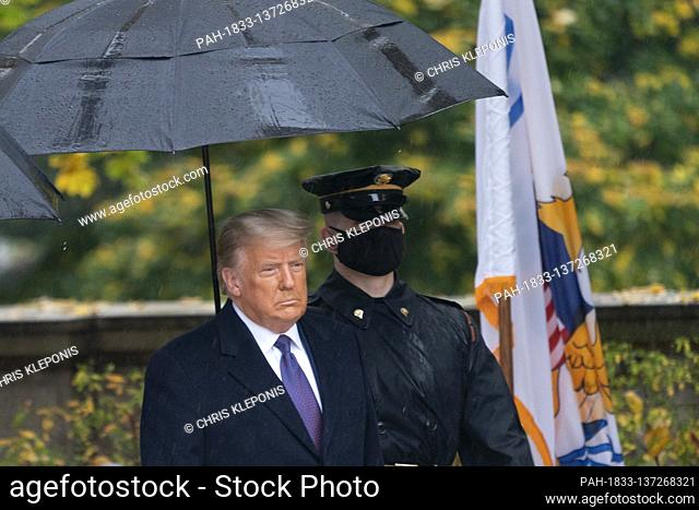 United States President Donald J. Trump and First lady Melania Trump participate in a National Veterans Day Observance at Arlington National Cemetery in...