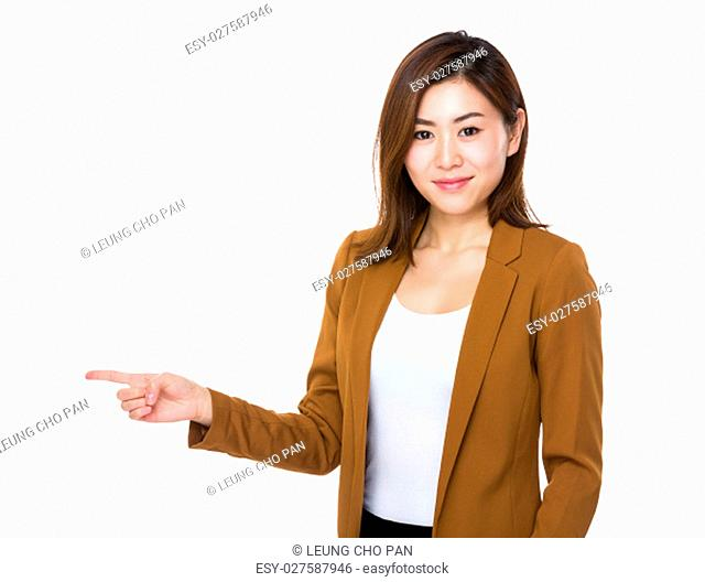 Asian young businesswoman with finger point aside