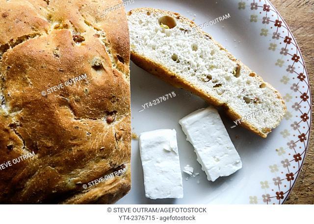Greek Cuisine. Tradirional Olive Bread Eliopsomo with Feta Cheese