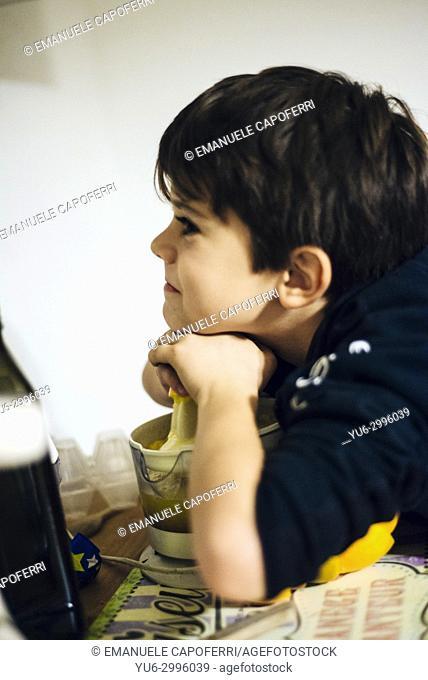 Boy squeezes oranges