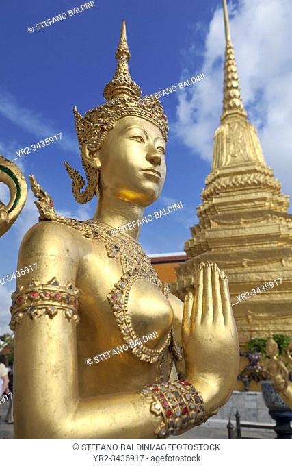 Statue of Kinnari, traditional symbol of feminine beauty at Wat Phra Kaeo, the Royal Grand Palace, Bangkok, Thailand