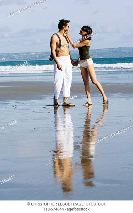 couple sightseeeing on beach
