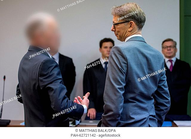 Former vice-president of Krauss-Maffei Wegmann (KMW) defence company Olaf E. (L) talks to his lawyer Rainer Spatscheck at the beginning of his trial at the...