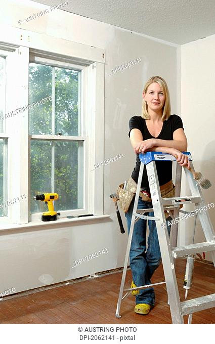 Woman Holding Paint Brush, For Home Renovations