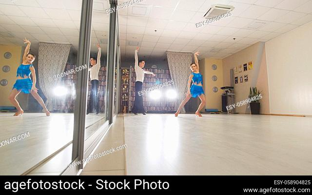 Dancers standing in a pose for dance, telephoto shot
