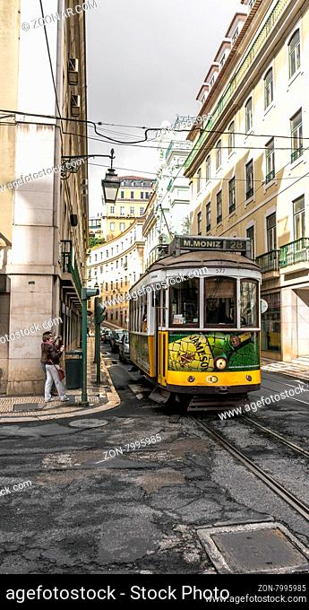 LISBON, PORTUGAL- MARCH 23, 2013: Historic classic yellow tram of Lisbon built partially of wood