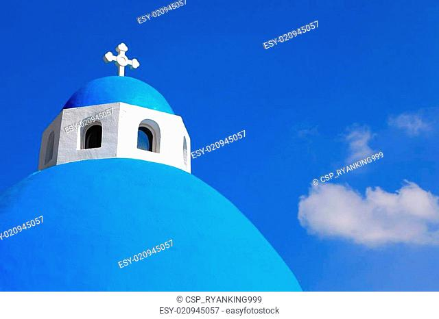 Beautiful Cross with blue sky and white cloud in greece
