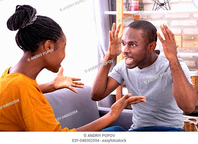 An Angry Young Man Scolding To His Wife At Home
