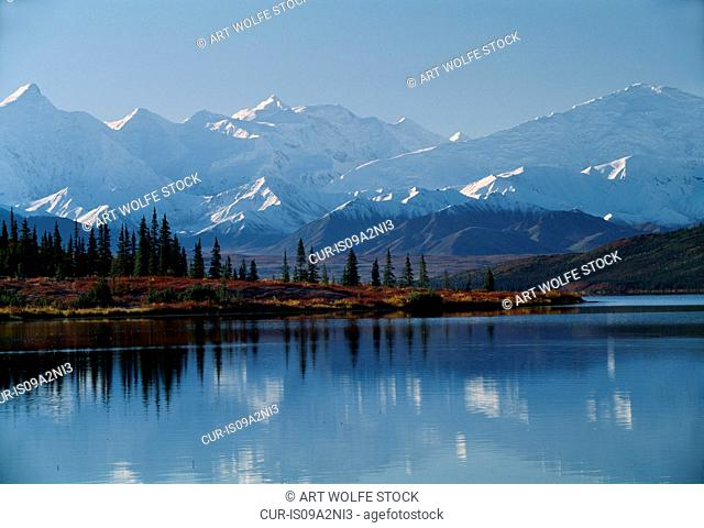 The Alaska Range reflected in the serene Wonder Lake, Denali National Park, Alaska