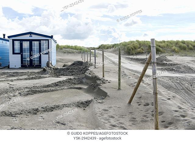 Hook of Holland Beach, Netherlands. Beach houses on the coast, with view on the North Sea and used for recreational purposes
