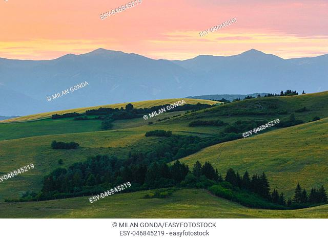 Rural landscape with fields and meadows in Turiec region, central Slovakia.
