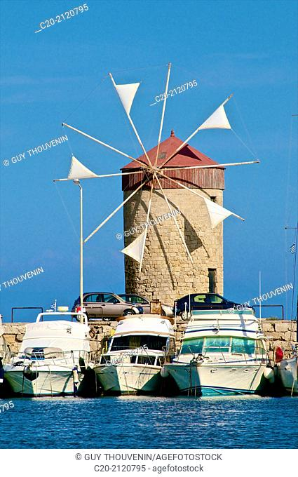 Windmills and tourists boats , in Mandraki harbor, Rhodes town , Rhodes island, Greece