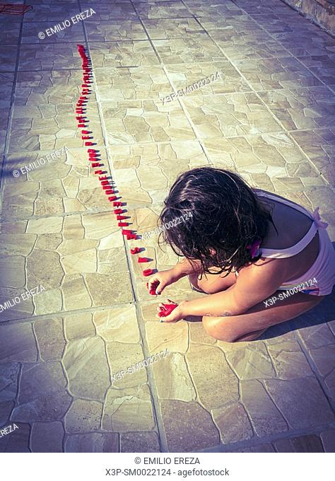 Little girl playing with letters. ,